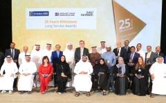 الصورة: الصورة: «الإمارات دبي الوطني» يكرّم 26 موظفاً وموظفة