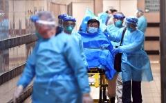 الصورة: الصورة: ارتفاع حصيلة وفيات كورونا في الصين إلى 425 شخصاً
