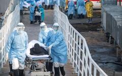 الصورة: الصورة: ارتفاع حصيلة وفيات كورونا في الصين إلى 563 شخصاً
