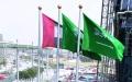 الصورة: الصورة: عَلَم السعودية يرتفع في موقع إكسبو