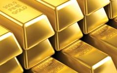 الصورة: الصورة: الذهب مستقر وارتفاع الدولار يكبح المكاسب