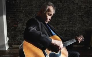 الصورة: الصورة: وفاة المغني الأمريكي جون براين بسبب مضاعفات فيروس كورونا