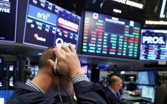 الصورة: الصورة: كورونا يتلاعب بمؤشرات الأسهم العالمية