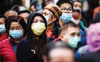 الصورة: الصورة: ملياردير يوزع 10 ملايين كمامة عن طريق ماكينات البيع في أنحاء هونغ كونغ