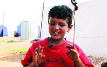 الصورة: الصورة: حسن وعصام.. طفلان حلمهما العودة إلى البيت