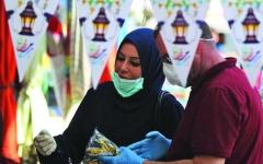 الصورة: الصورة: عيد الفطر بنكهة «كورونا» في العراق