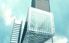 الصورة: الصورة: بالفيديو.. اكتمال عملية تجميع وحدات أعلى مبنى معلّق في العالم بدبي