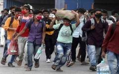 الصورة: الصورة: الهند تعزل 125 مليون شخص.. وكورونا يواصل انتشاره