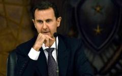 الصورة: الصورة: توعّك مؤقت يضطر  الأسد لقطع كلمته