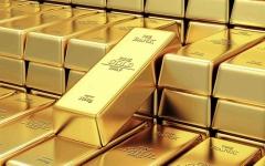 الصورة: الصورة: الذهب ينخفض مع صعود الدولار