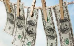 الصورة: الصورة: نحو تريليوني دولار تحويلات الأموال القذرة عبر البنوك في العالم