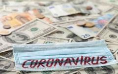 الصورة: الصورة: العلماء يحددون مدة عيش فيروس كورونا على النقود