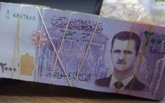 الصورة: الصورة: الرئيس السوري يوجه بصرف منحة مالية للموظفين