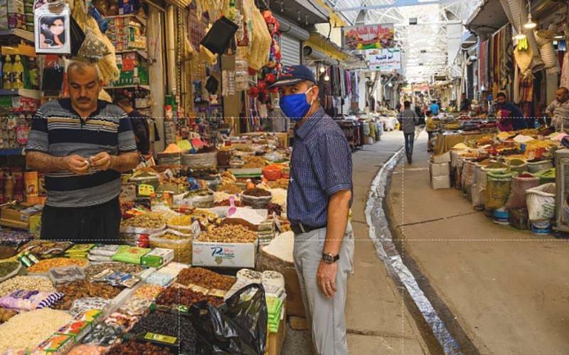 الصورة: الصورة: عودة الحركة إلى سوق البورصة الرئيسي بالموصل بعد الحرب المدمرة