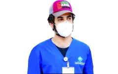 الصورة: الصورة: منصور البلوشي.. 3000 ساعة تطوعية في مكافحة كورونا