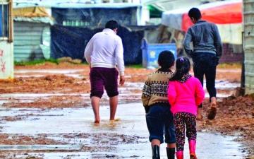 الصورة: الصورة: «كرفانات» مهترئة تضاعف معاناة لاجئي «الزعتري»