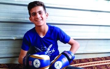 الصورة: الصورة: طفل في مخيم الزعتري يتحدى المعاناة بالإبداع في الرياضة