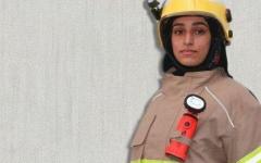 الصورة: الصورة: نوف آل علي إطفائية تجد سعادتها في الميدان