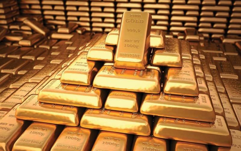 الصورة: الصورة: الذهب ينزل 1% مع صعود الدولار وعوائد السندات