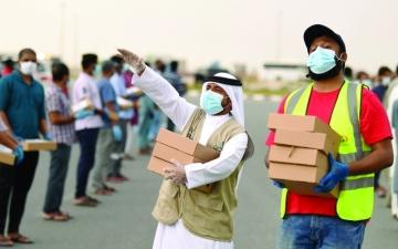 الصورة: الصورة: إفطار رمضان الخير يجري في شوارع الإمارات