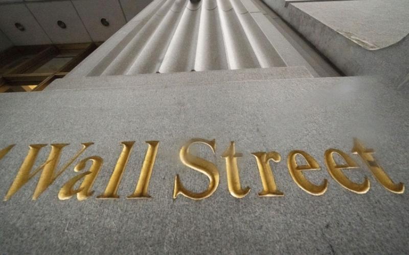 الصورة: الصورة: تعافي الأسواق العالمية بانتعاش بورصة «وول ستريت»