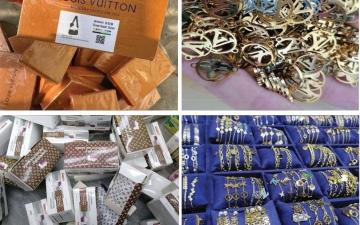 الصورة: الصورة: شرطة عجمان تضبط 120 ألف قطعة مقلدة لعلامات تجارية عالمية بقيمة 30 مليـون درهـم