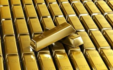 الصورة: الصورة: الذهب يتراجع مع تقدم الدولار