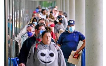 الصورة: الصورة: طلبات إعانة البطالة الأمريكية تنخفض عن 400 ألف