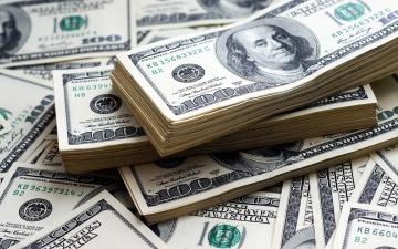 الصورة: الصورة: الدولار قرب قمة 3 أسابيع