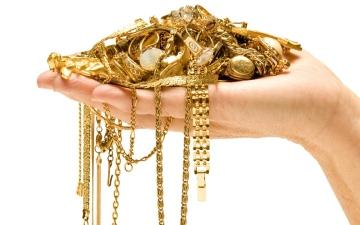 الصورة: الصورة: تراجع أسعار الذهب مع صعود الدولار