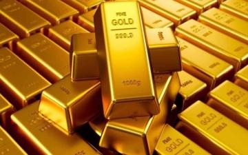 الصورة: الصورة: الذهب ينزل بفعل ارتفاع الدولار