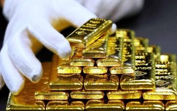 الصورة: الصورة: الذهب يهبط بفعل صعود الدولار