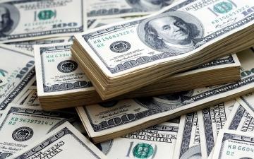 الصورة: الصورة: الدولار يرتفع وسط ترقب تغيرات مستقبلية في السياسة النقدية الأمريكية