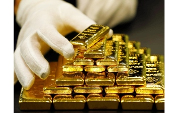 الصورة: الصورة: الذهب يخسر 2% بفعل ميل الاحتياطي الأمريكي إلى «التشديد النقدي»