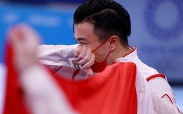 الصورة: الصورة: الصيني ليو يحرز ذهبية جهاز الحلق للرجال