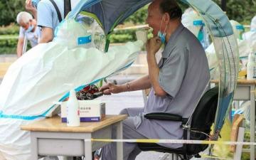 الصورة: الصورة: الصين تفرض إغلاقاً على ملايين السكان مع انتشار دلتا