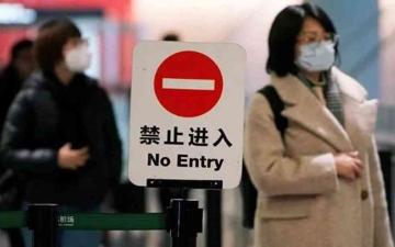 الصورة: الصورة: لاحتواء الموجة.. الصين تفرض إغلاقاً على مدينة تعد أربعة ملايين نسمة